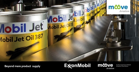 Yellow Mobil Jet Oil 387 barrels on an industrial conveyor belt, bending round to the left of view