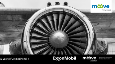 Vintage style image in greyscale featuring a large jet engine attached to a plane, photographed in a close up format